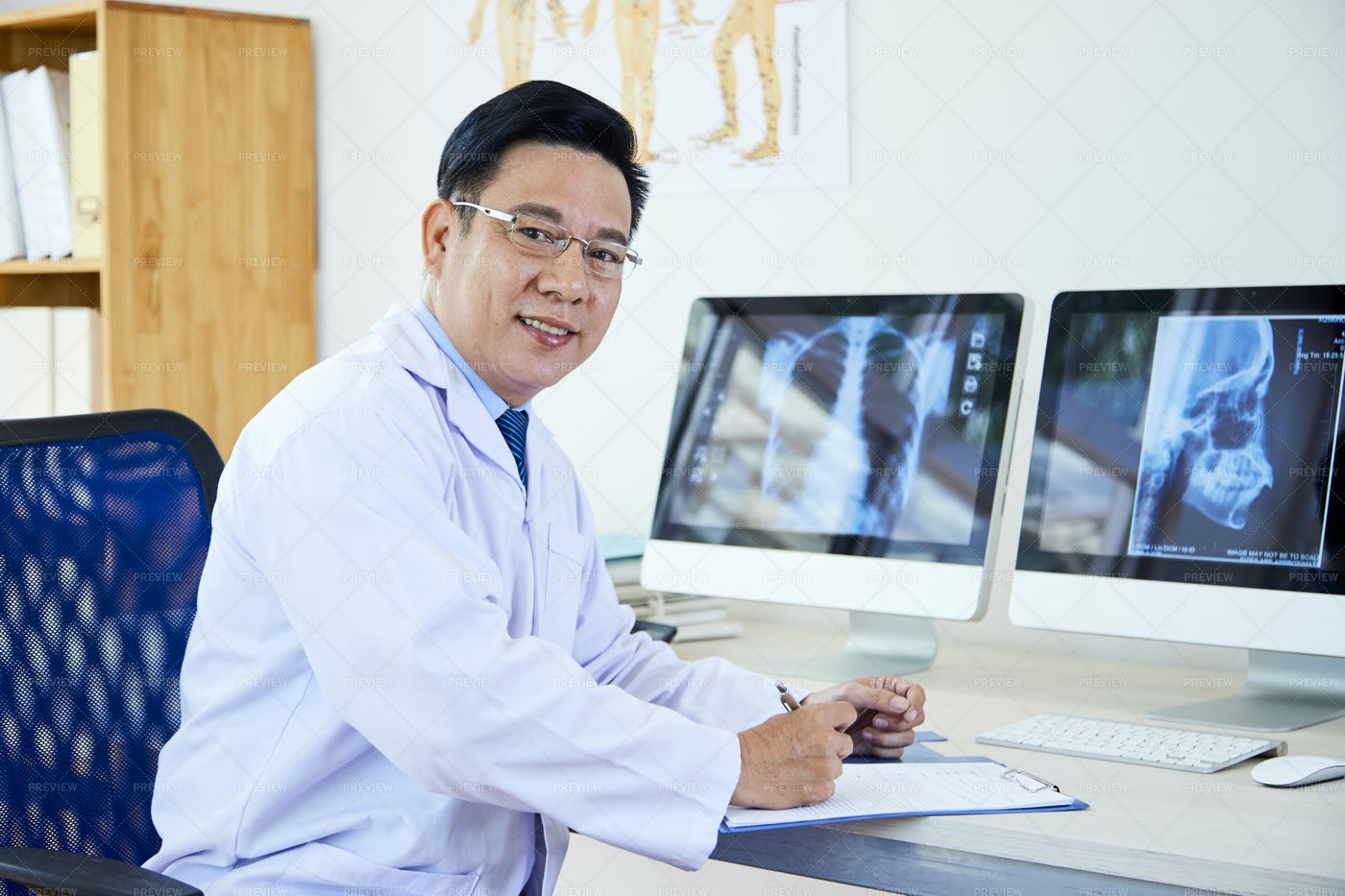 Radiologist Working With X-ray Image: Stock Photos