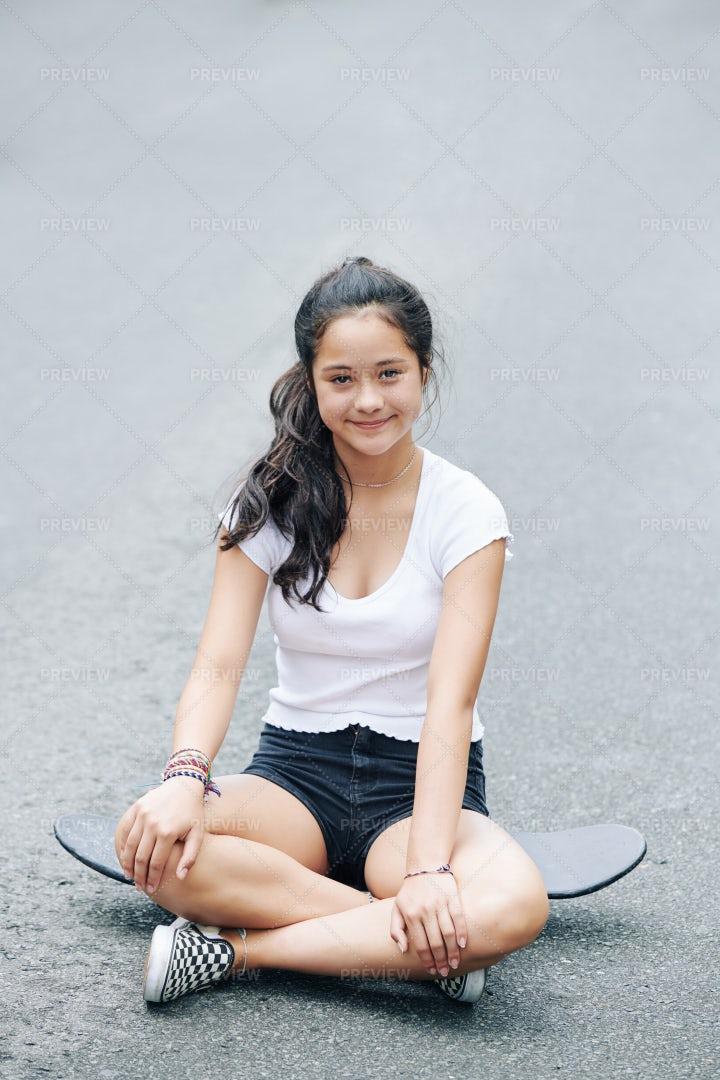 Girl Resting On Skateboard: Stock Photos