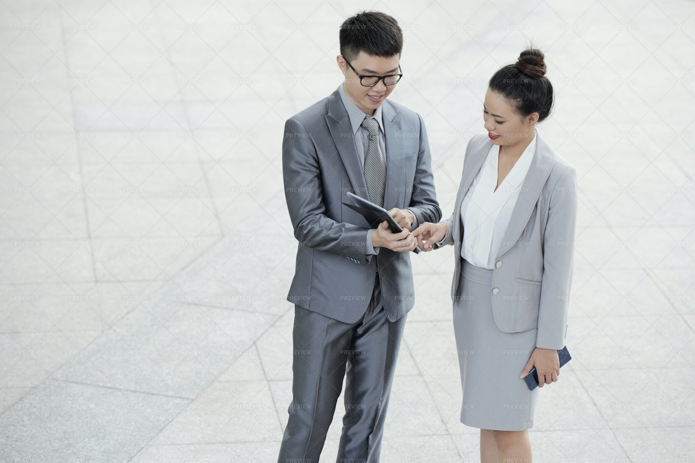 Entrepreneurs Checking Data On Tablet: Stock Photos