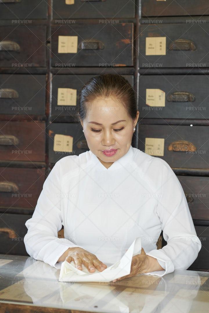 Mature Asain Woman Working As: Stock Photos