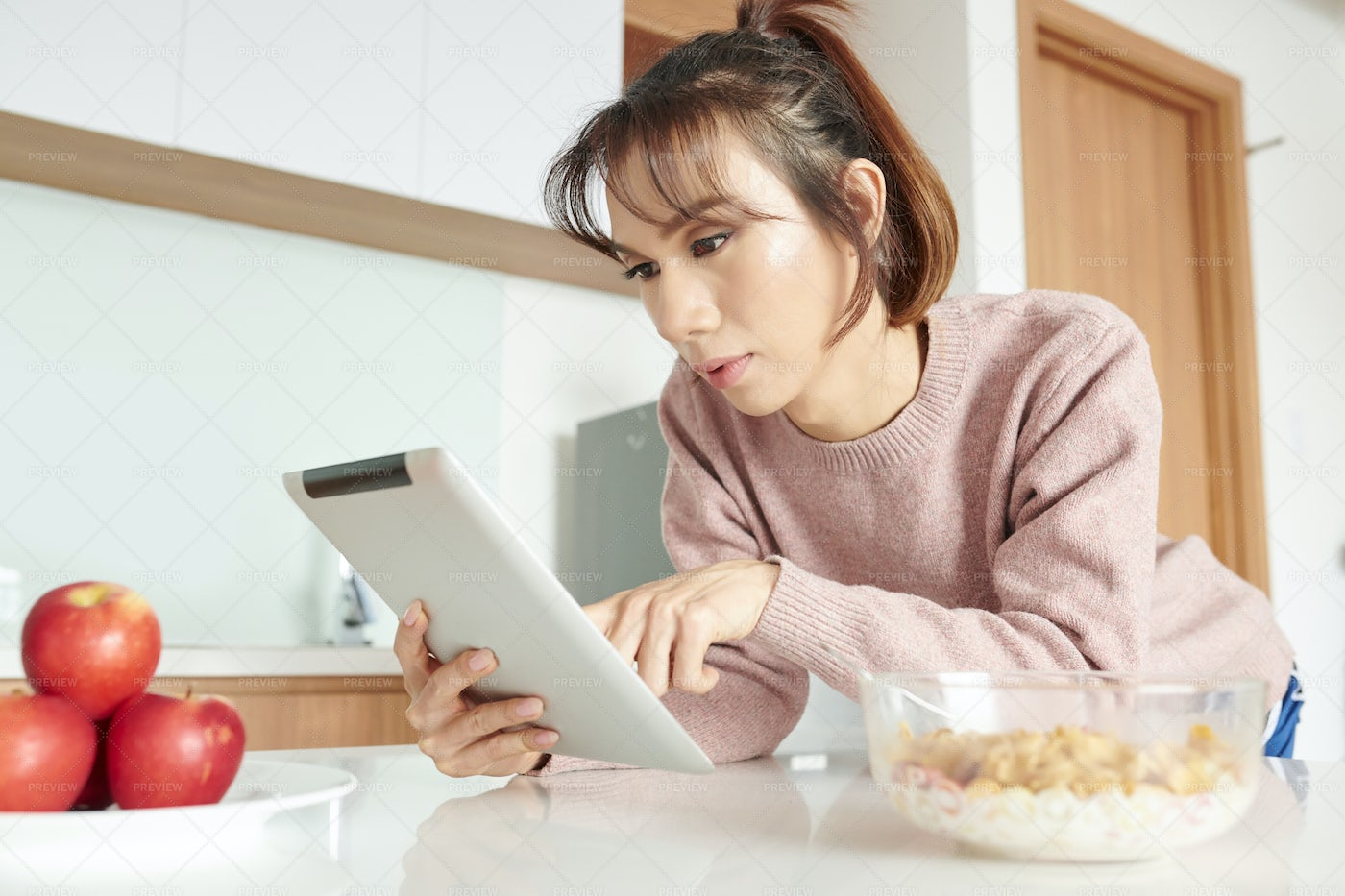 Woman Using Tablet Pc During Breakfast: Stock Photos