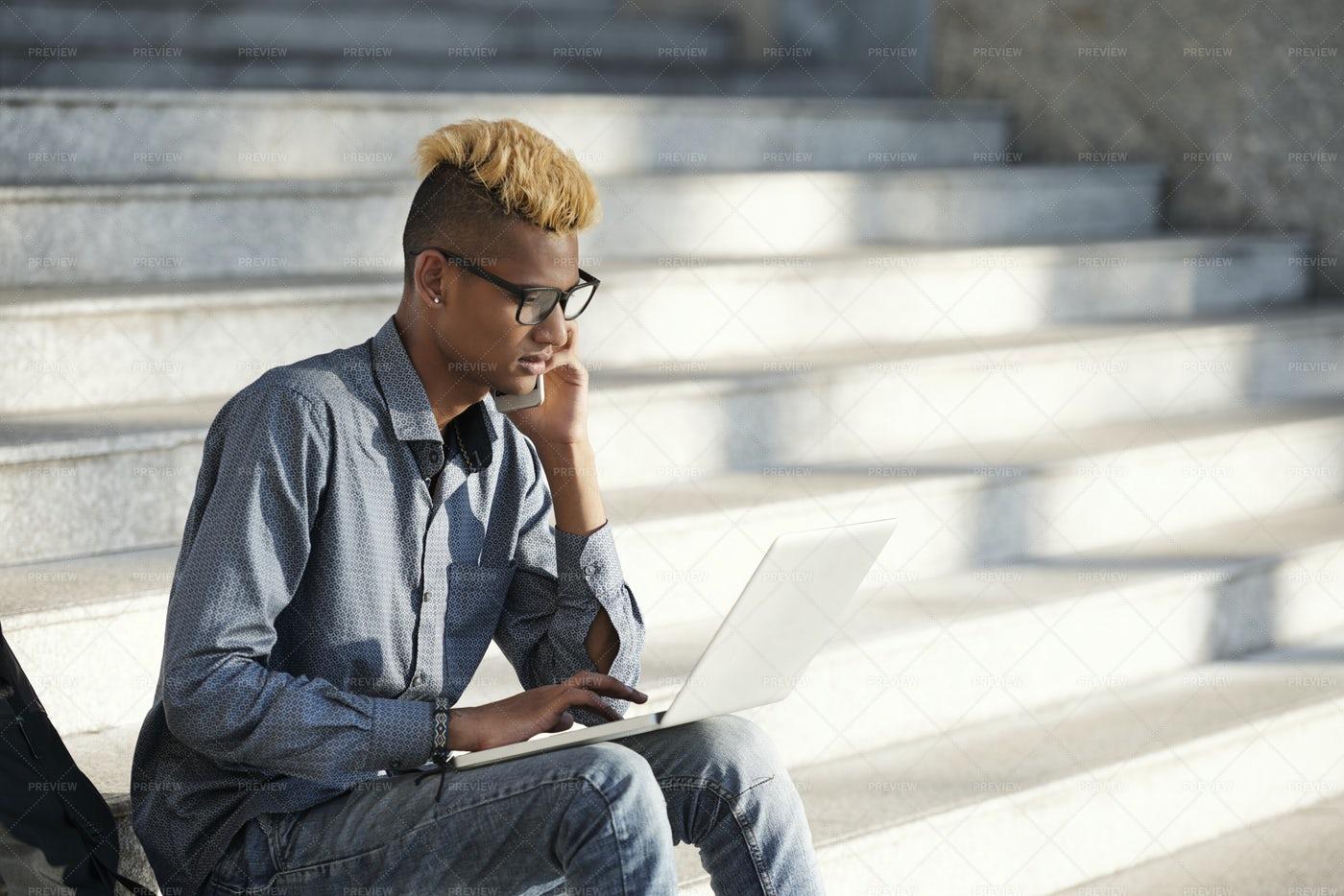 Young Man Working Outdoors: Stock Photos