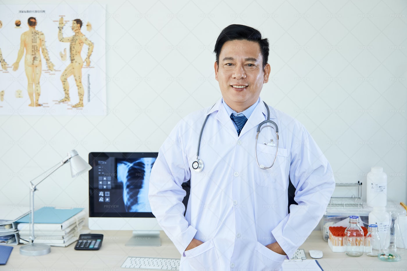 Male Neurologist Standing At Office: Stock Photos