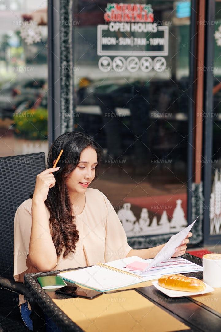 Businesswoman Checking Financial: Stock Photos