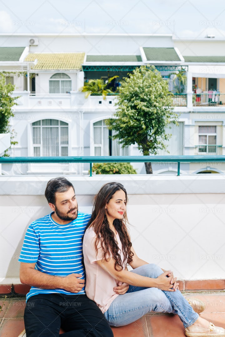 Couple Resting On Rooftop: Stock Photos