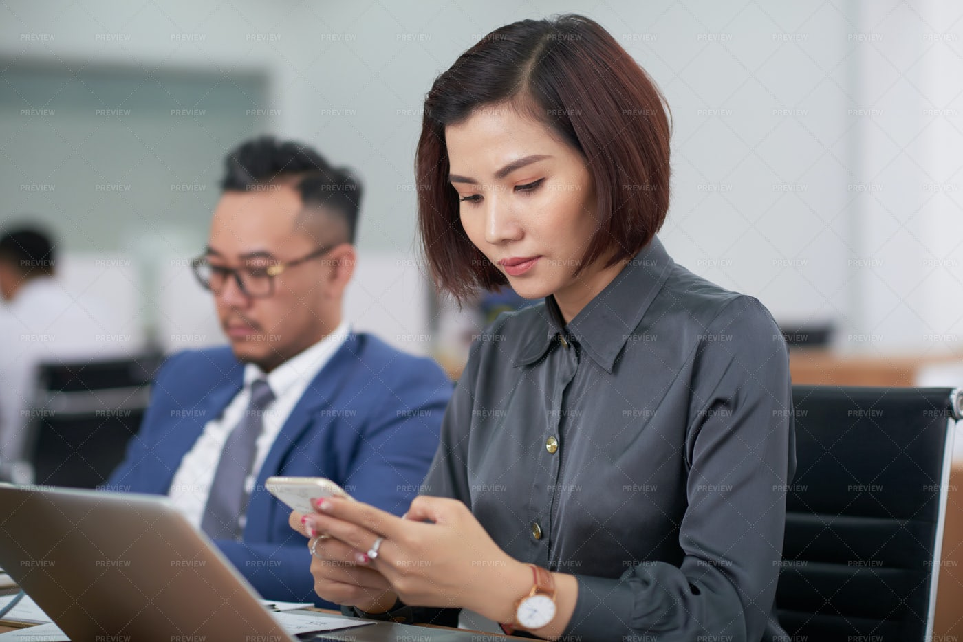 Businesswoman Using Mobile Phone During: Stock Photos