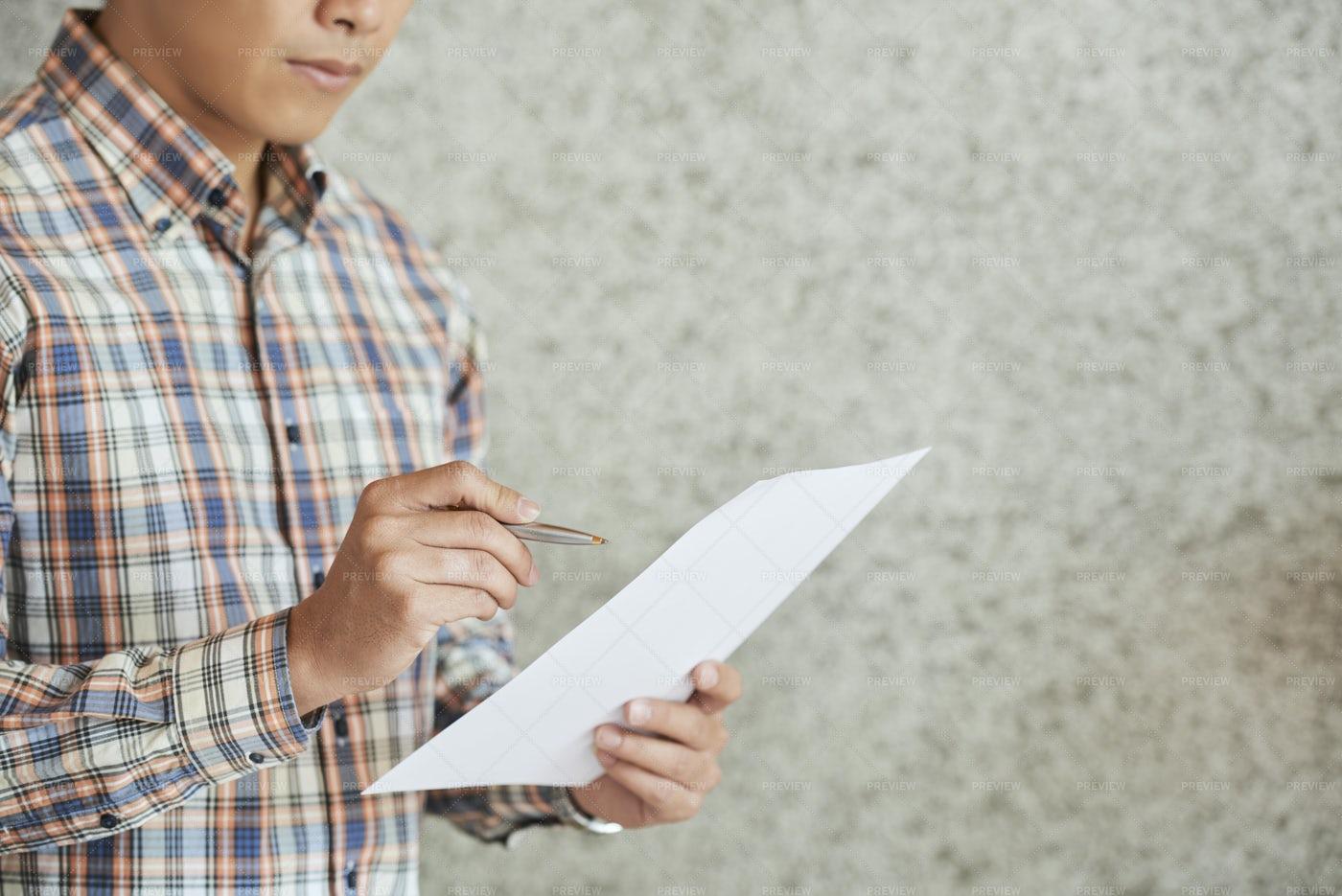 Entrepreneur Checking Business Document: Stock Photos