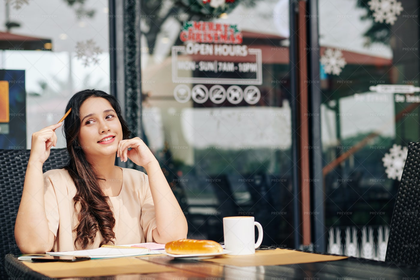 Pensive Student At Cafe Table: Stock Photos