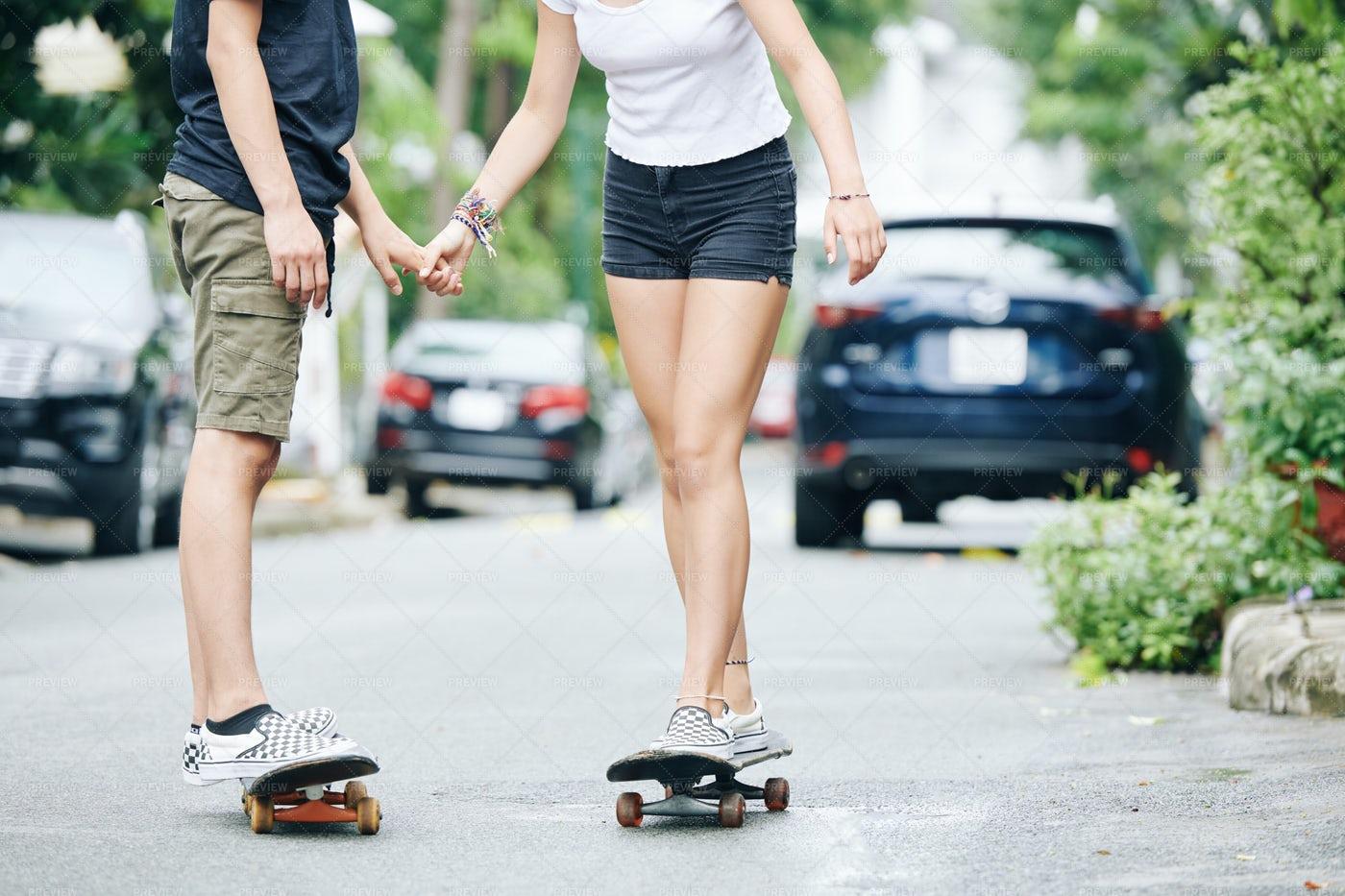 Boy Giving Fist Lesson Of Skateboardin: Stock Photos