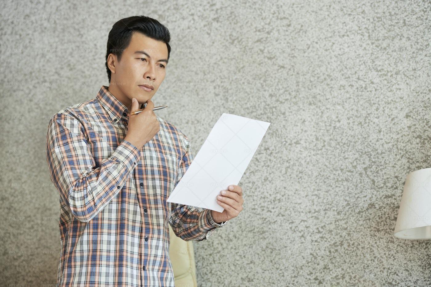 Entrepreneur Reading Document: Stock Photos
