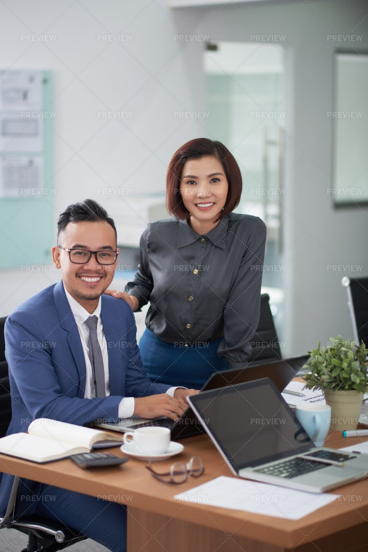 Business Partners Working In Team At: Stock Photos
