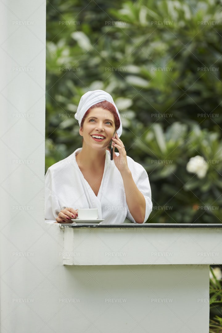 Woman Talking On Phone And Drinking: Stock Photos