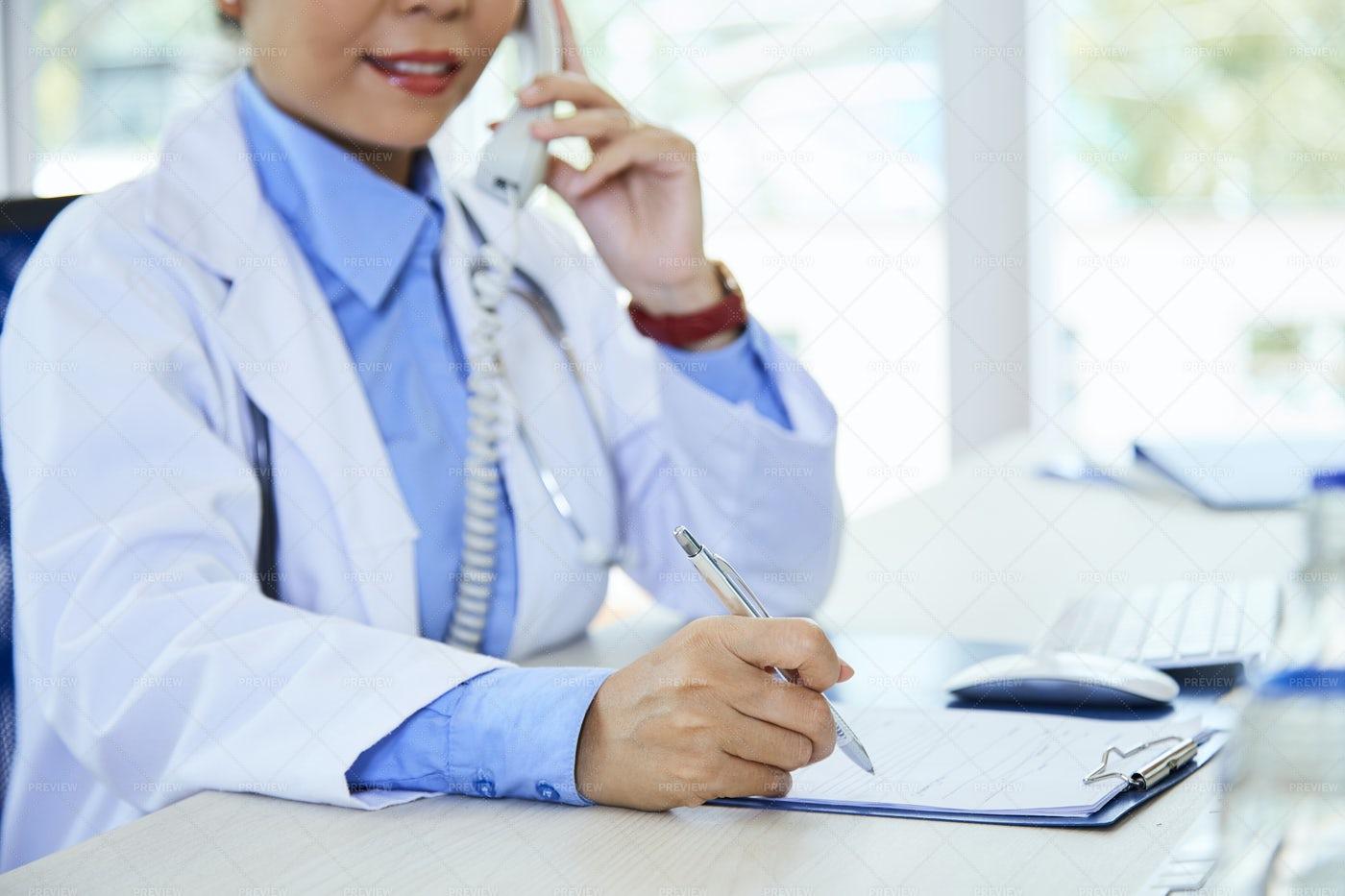 Doctor Writing A Prescription: Stock Photos