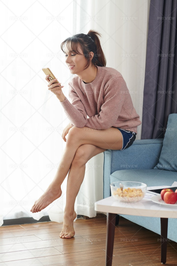 Woman Communicating On Mobile Phone: Stock Photos