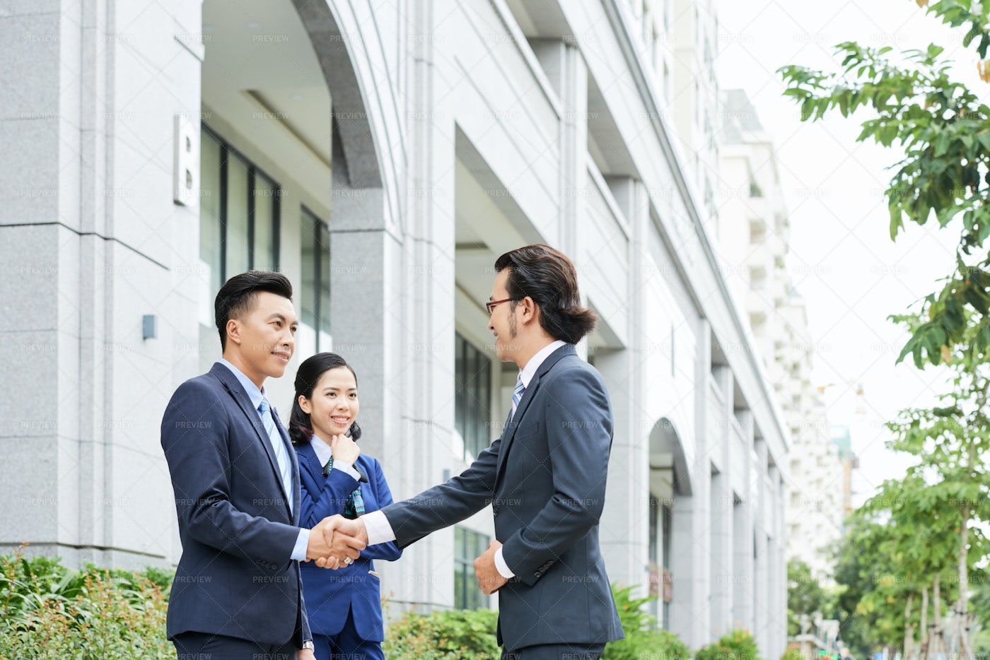 Businessman Greeting His Colleagues: Stock Photos
