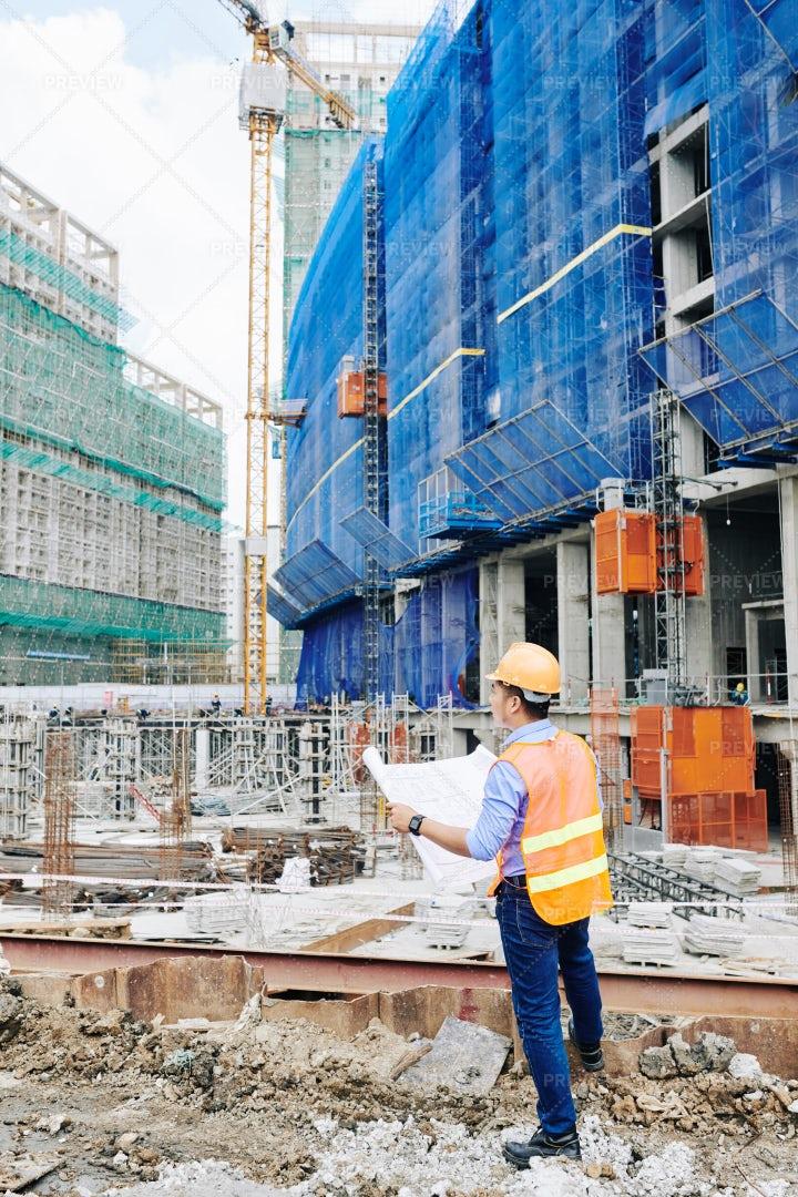 Engineer Checking Building Blueprint: Stock Photos