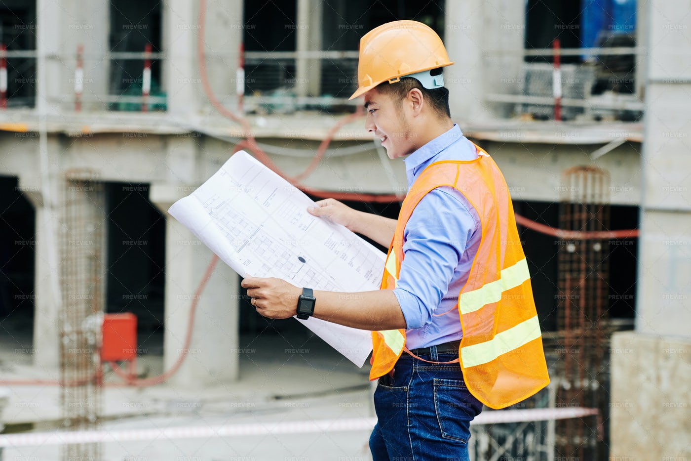 Smiling Foreman Checking Blueprint: Stock Photos