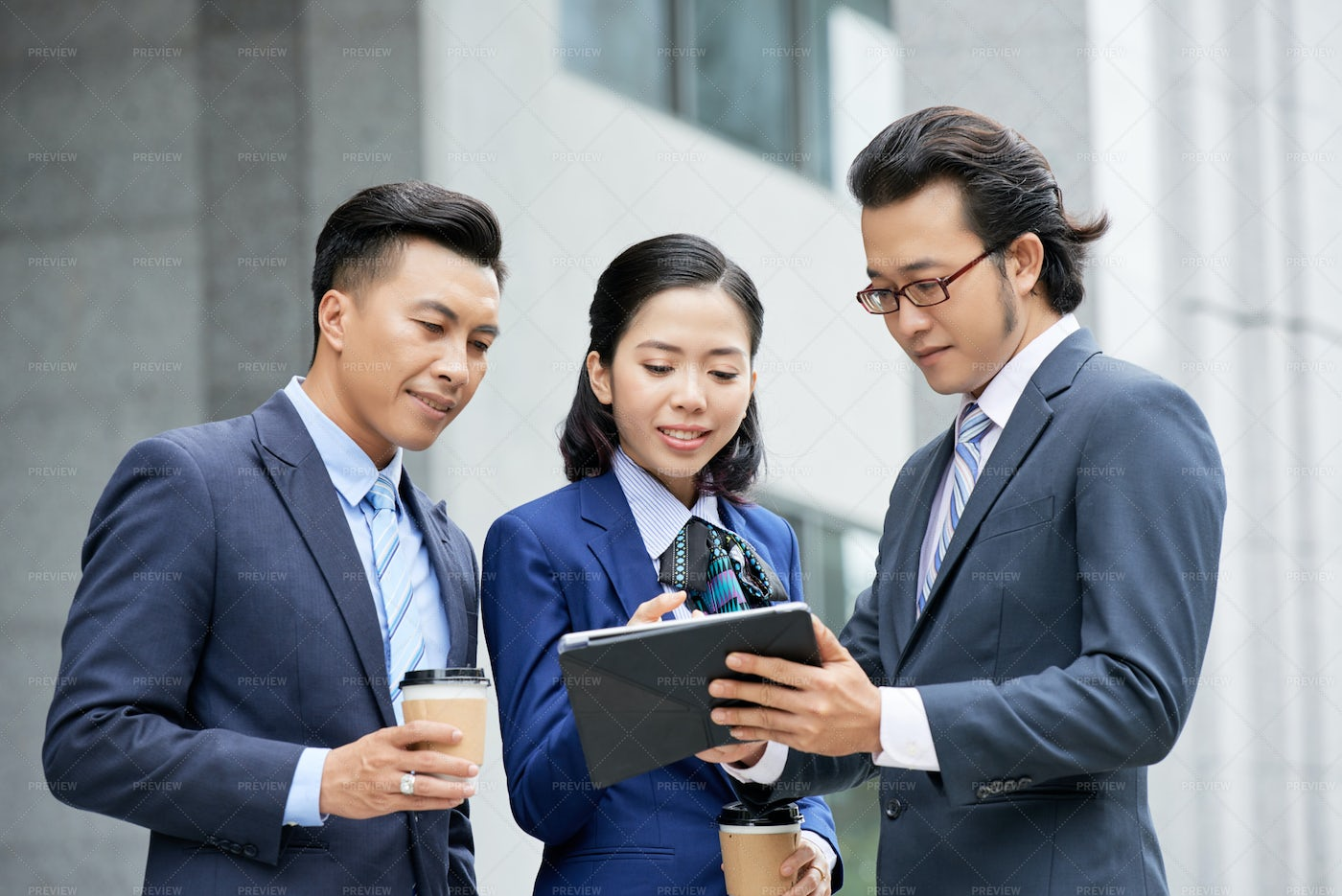 Business People Discussing Online: Stock Photos