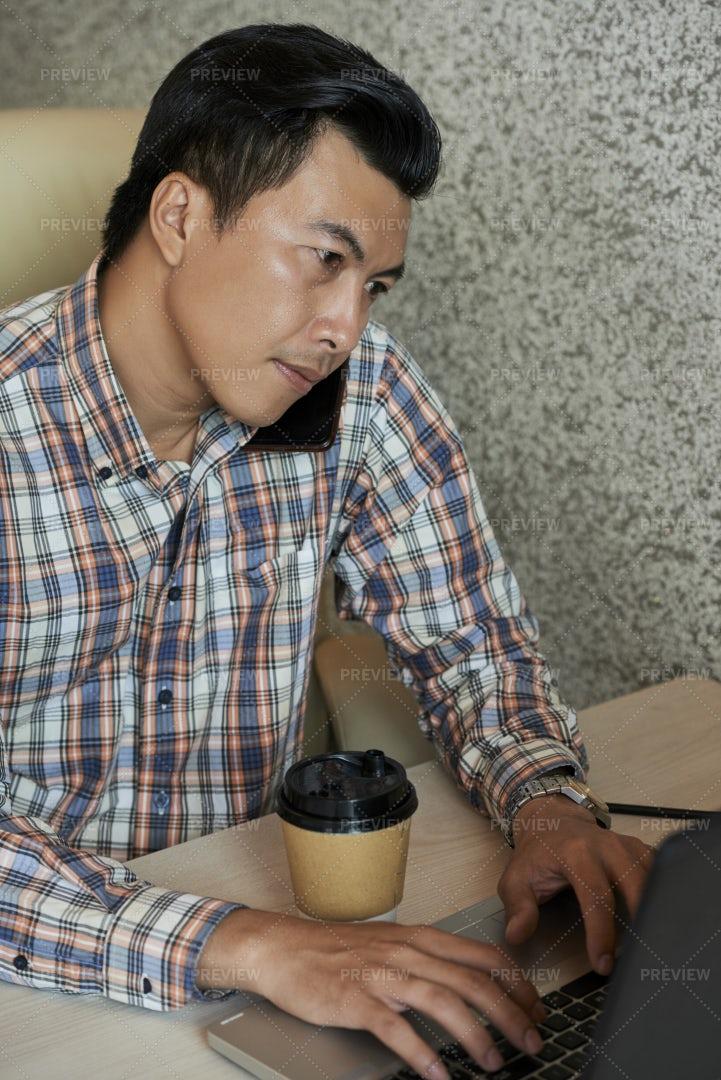 Software Developer Talking On Phone: Stock Photos