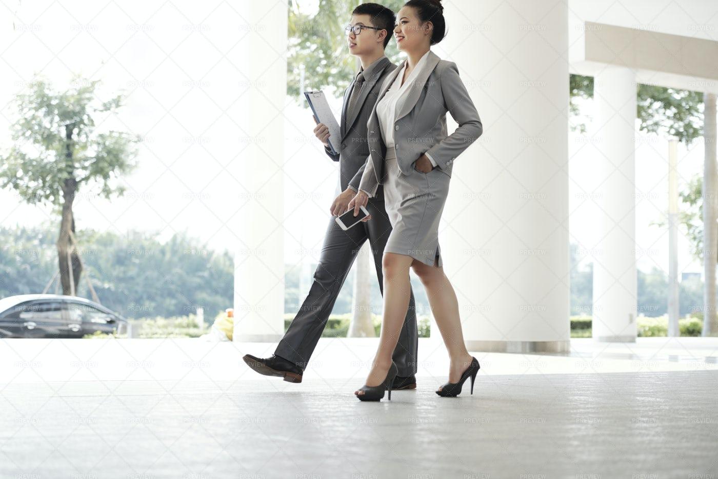 Walking Business Couple: Stock Photos