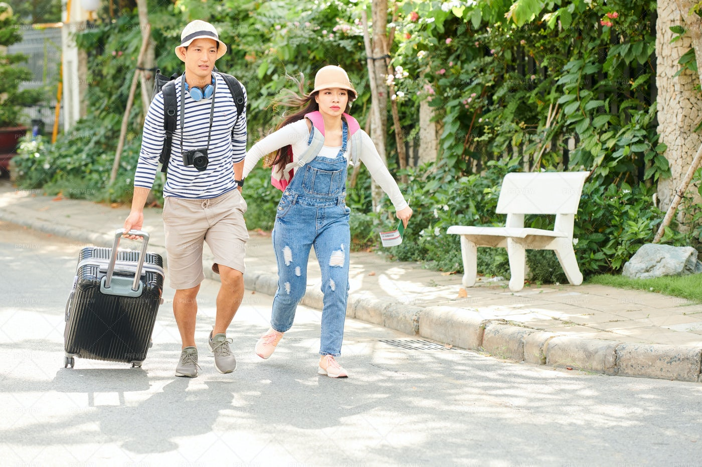Couple With Suitcase Hurrying To Bus: Stock Photos