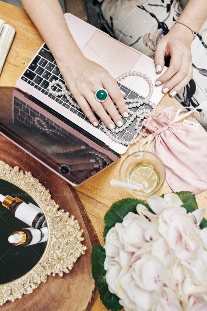 Woman Buying Jewelry Online: Stock Photos