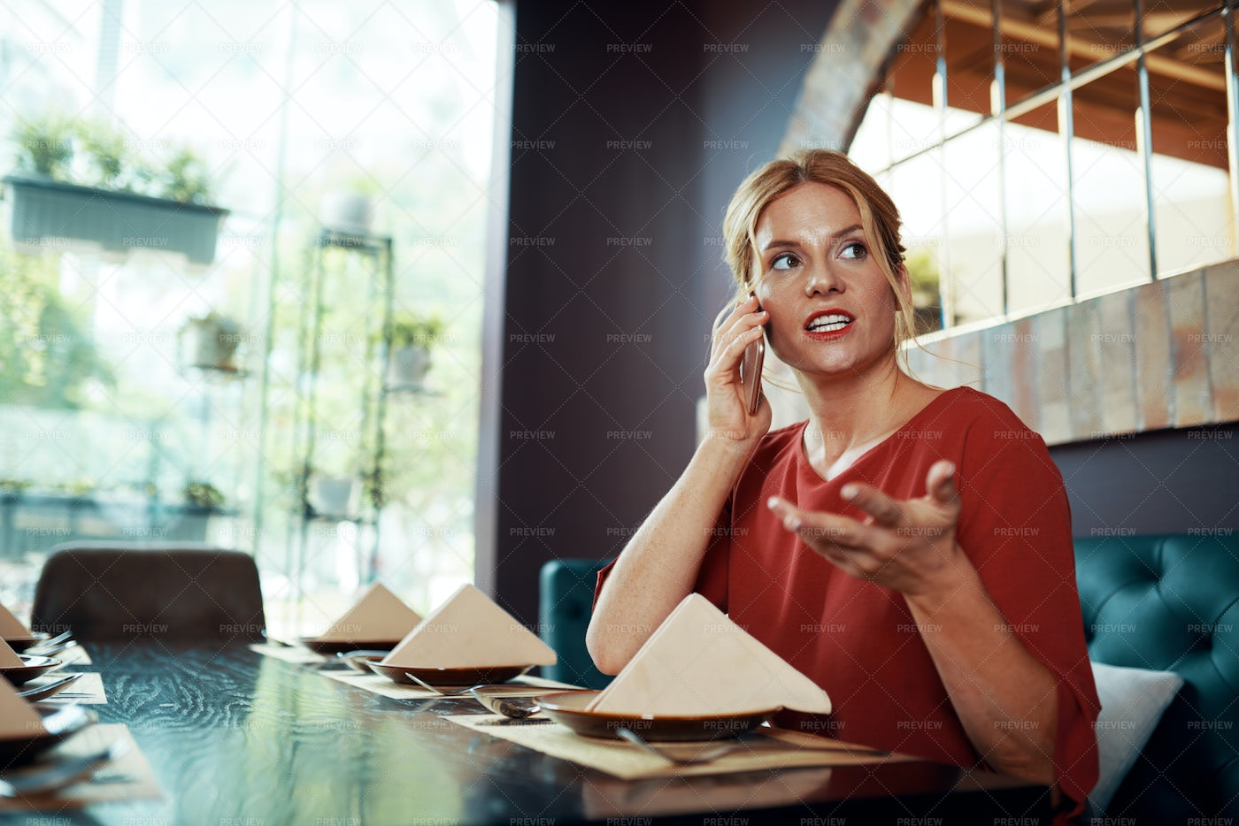 Woman Sitting At Restaurant And Talking: Stock Photos