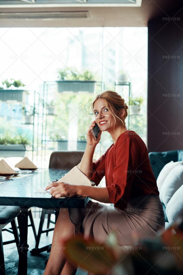 Smiling Woman Making Phone Call: Stock Photos
