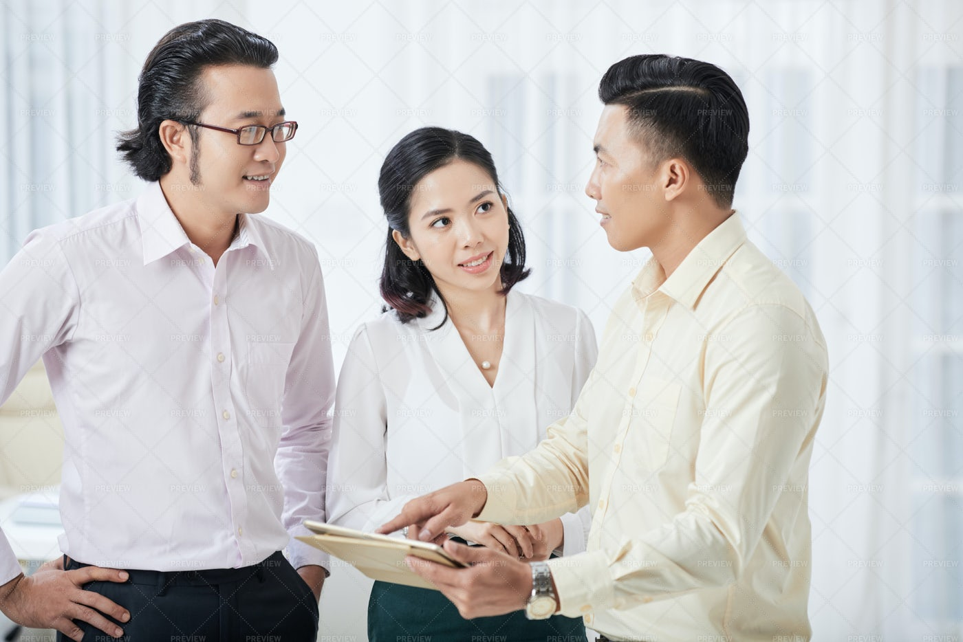 Business Partners Working On Tablet Pc: Stock Photos