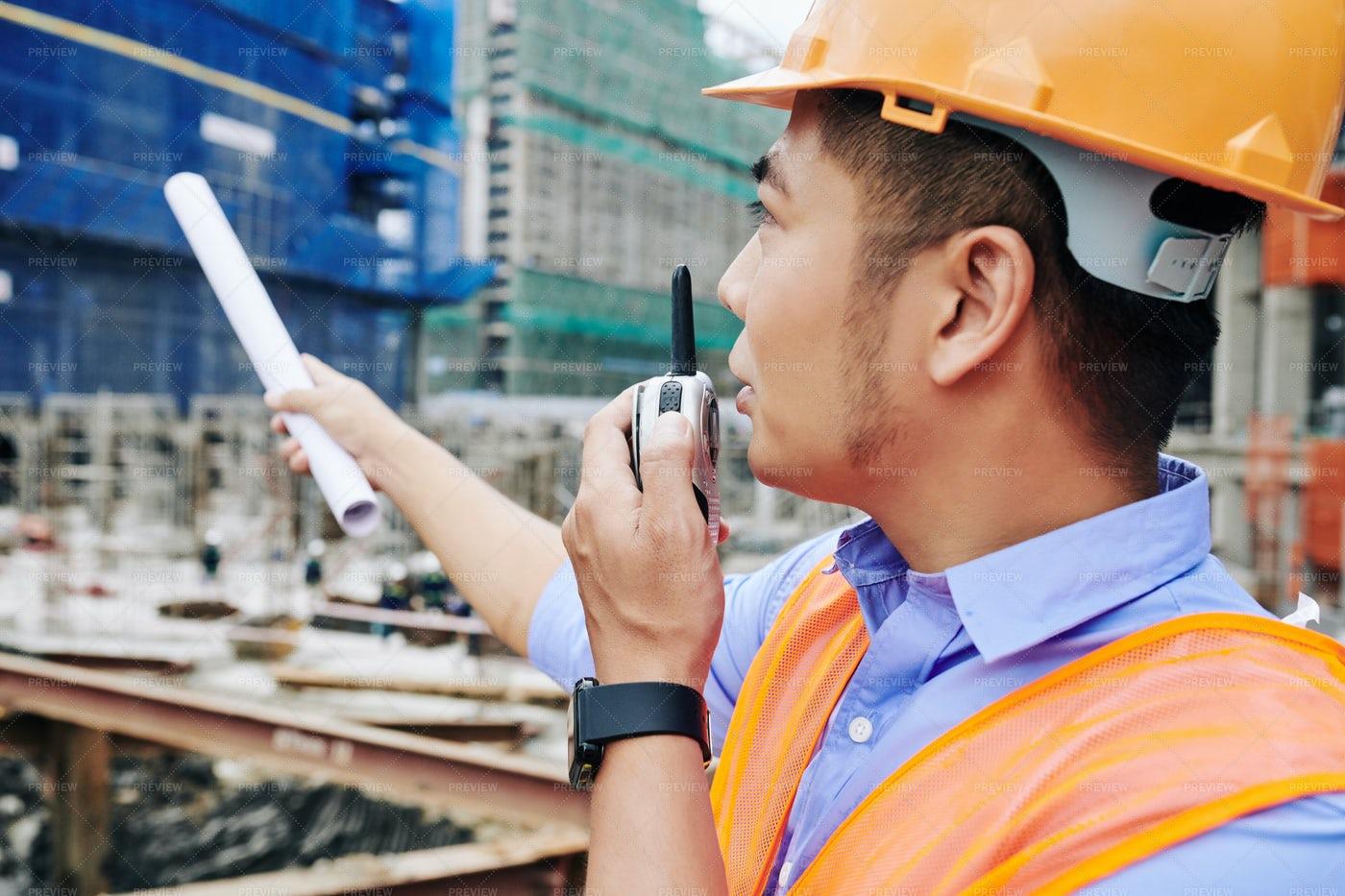 Contractor Talking On Walkie-talkie: Stock Photos