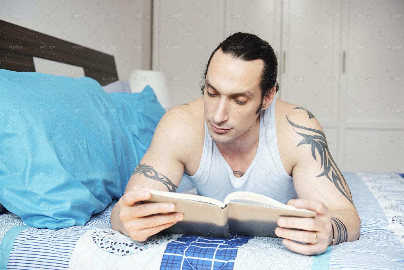 Man Reading A Book: Stock Photos