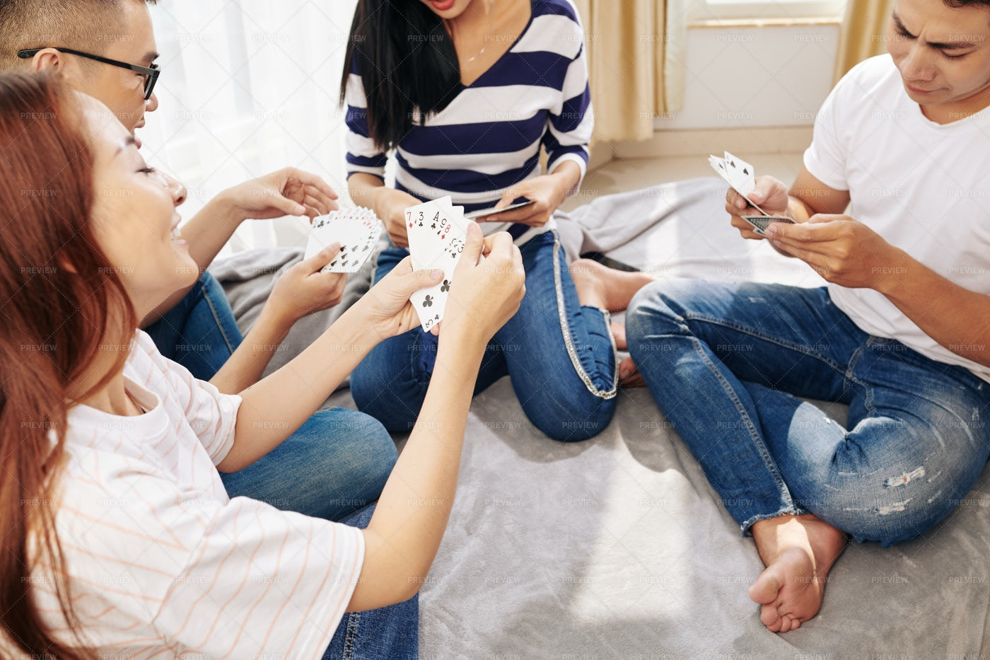 Playing Cards With Friends: Stock Photos