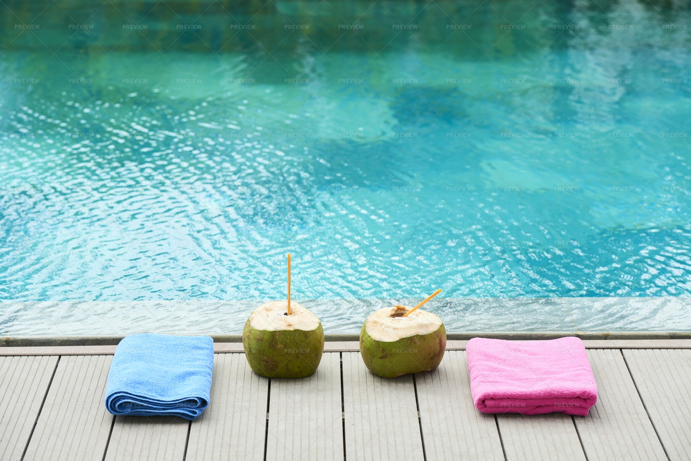Two Coconut Drinks Near The Pool: Stock Photos