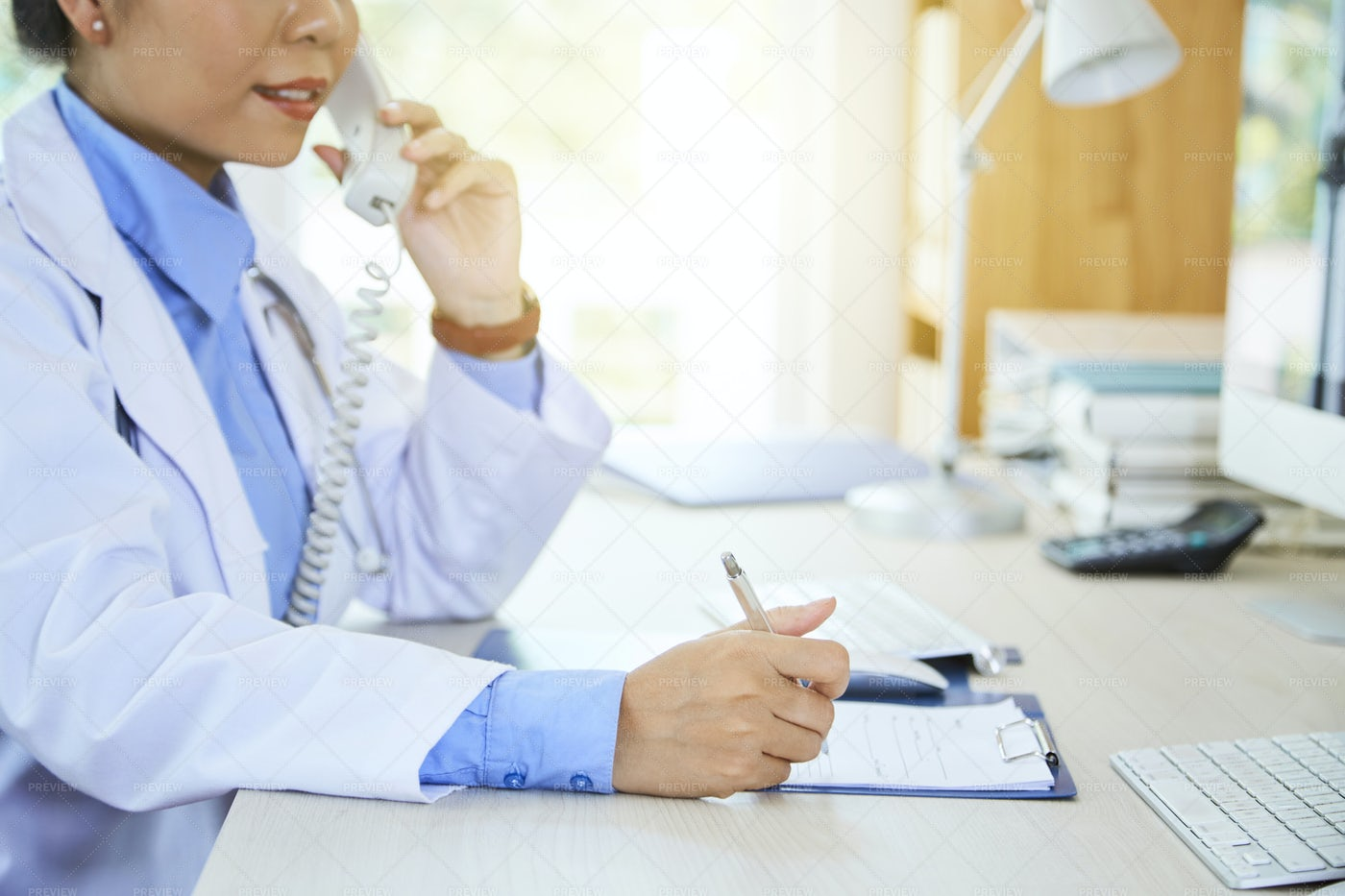 Doctor Talking On The Phone: Stock Photos