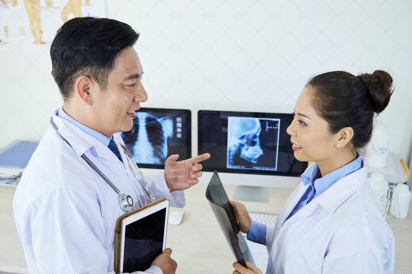 Two Radiologists Working In Team: Stock Photos