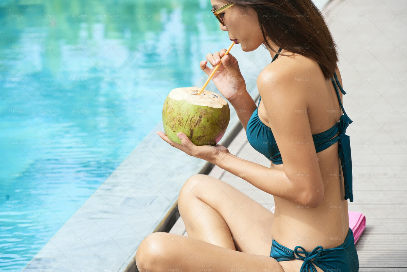 Woman Drinking Coconut Drink: Stock Photos