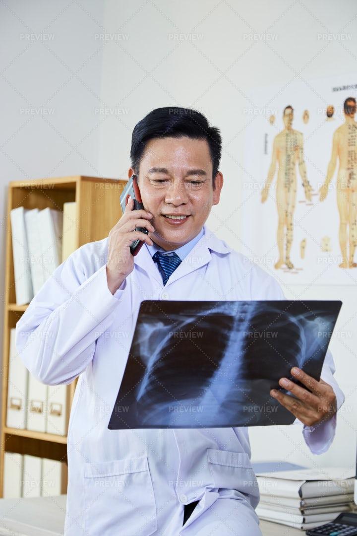 Asian Radiologist Examining The X-ray: Stock Photos