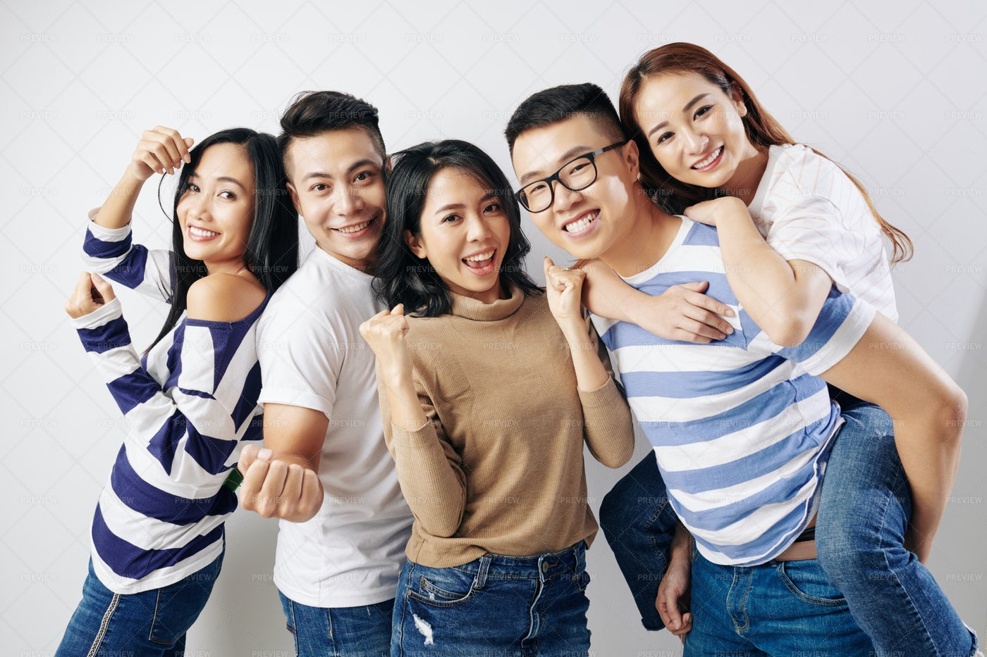 Cheerful Laughing Young Asian Friends: Stock Photos