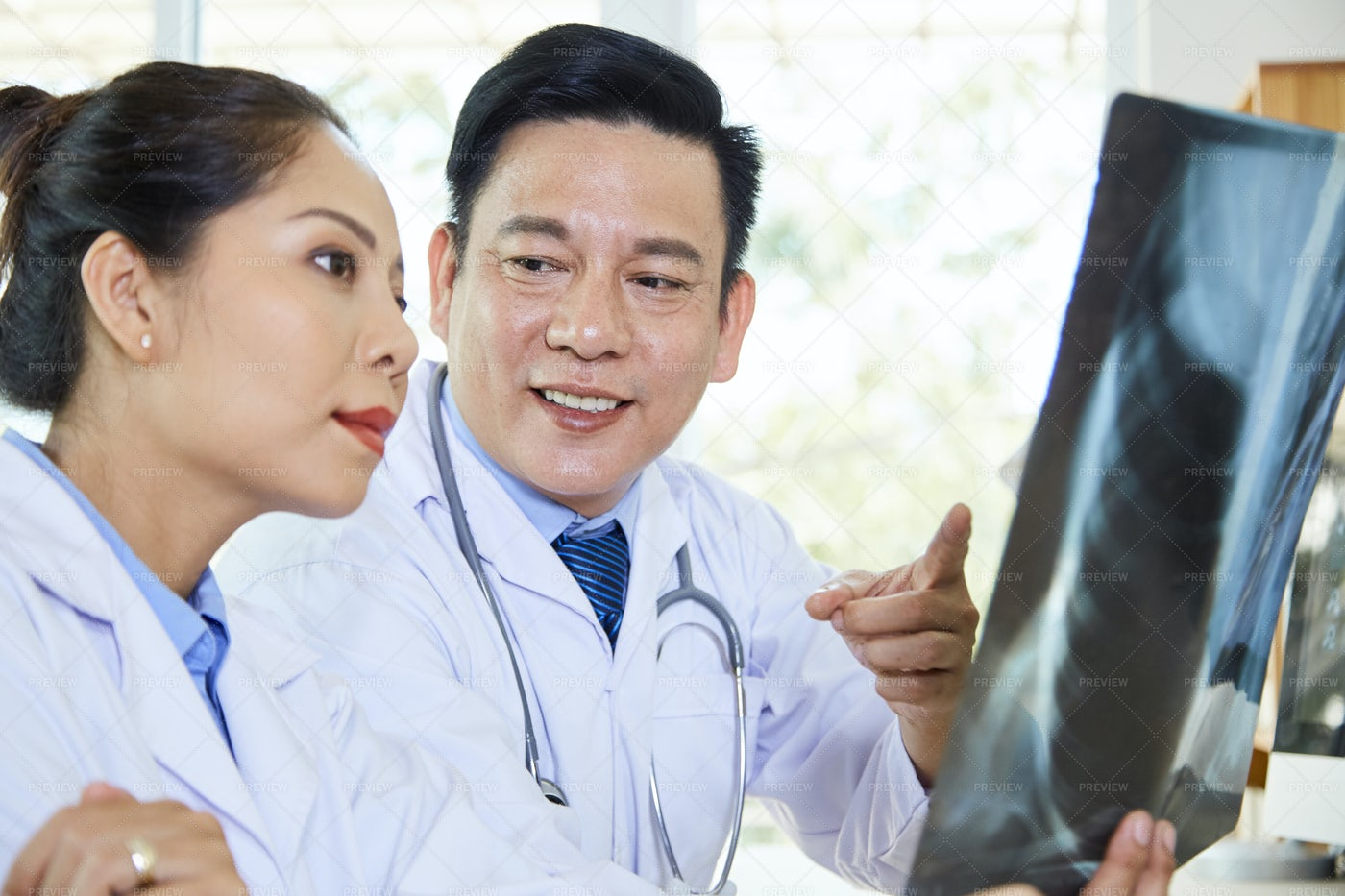 Doctors Working In Team At Hospital: Stock Photos
