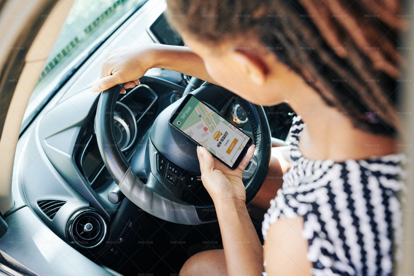 Woman Using Car Sharing Application: Stock Photos