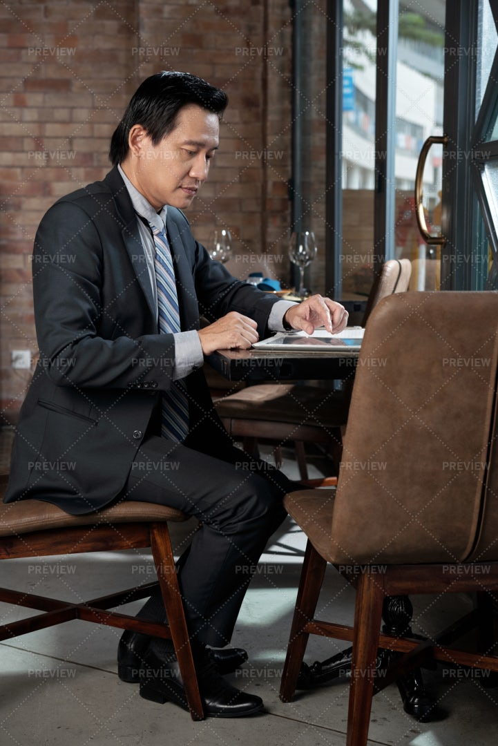 Businessman Working In Cafe: Stock Photos