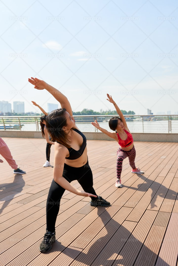 Group Of Women Doing Exercises Outdoors: Stock Photos