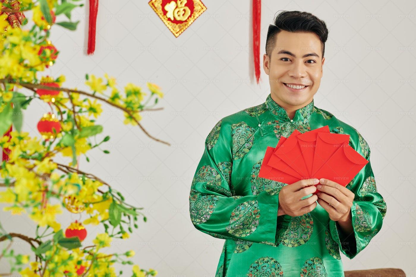 Man With Envelopes For Spring Festival: Stock Photos