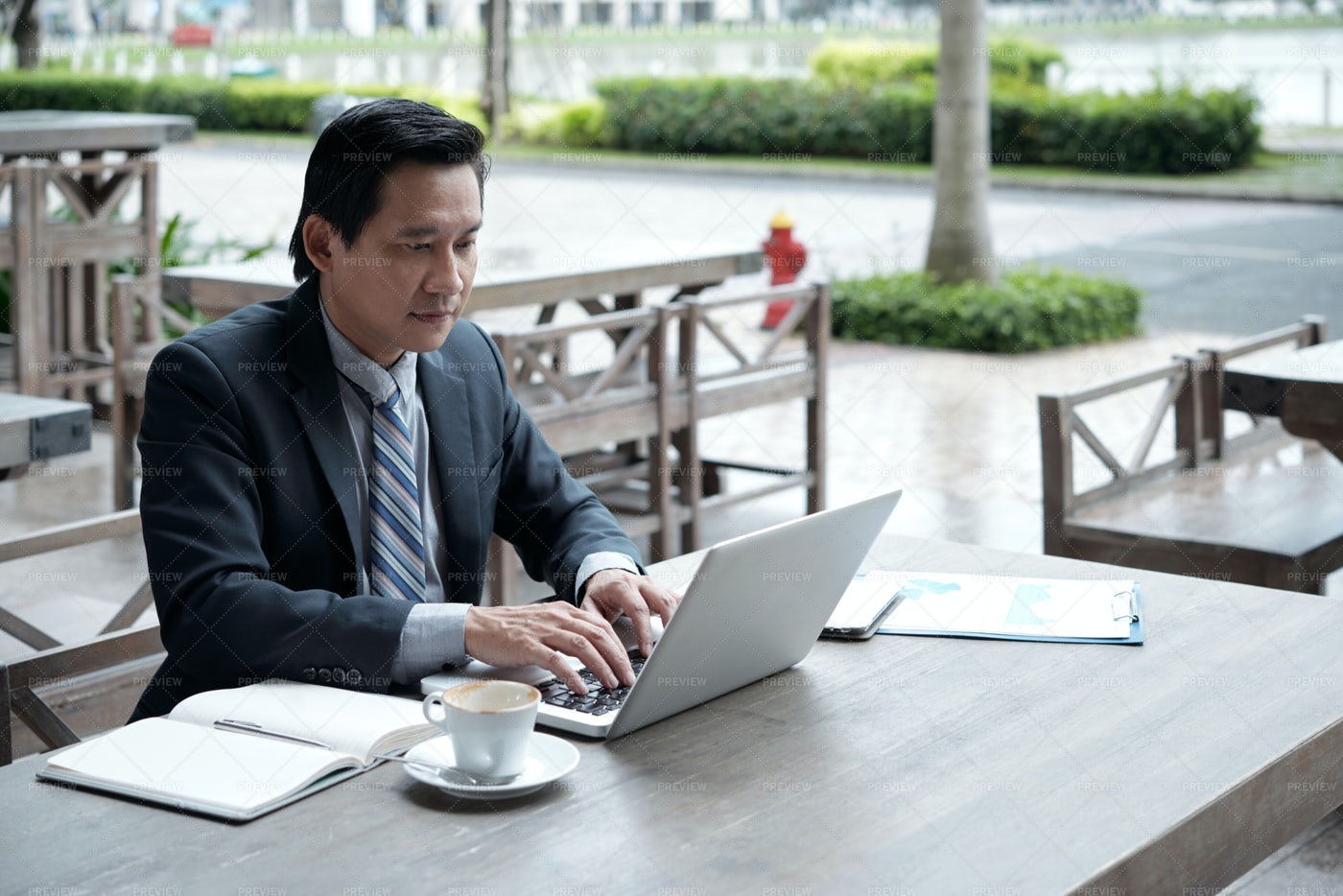 Businessman Working In Outdoor Cafe: Stock Photos