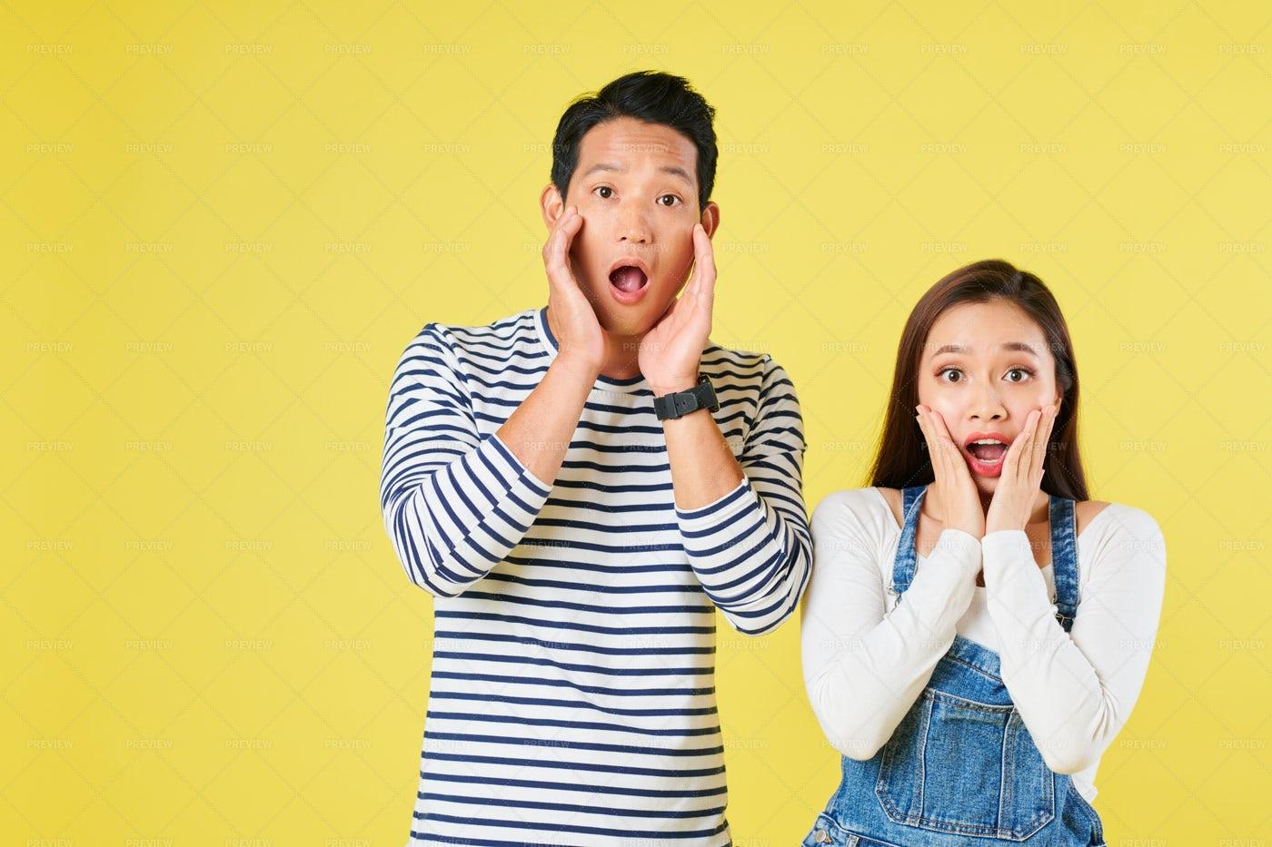 Amazed Shocked Young Couple: Stock Photos
