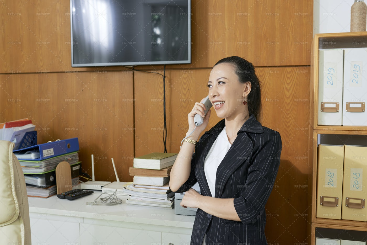 Businesswoman Talking On The Phone At: Stock Photos