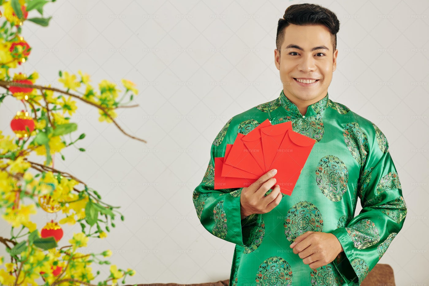 Young Man With Red Envelopes: Stock Photos