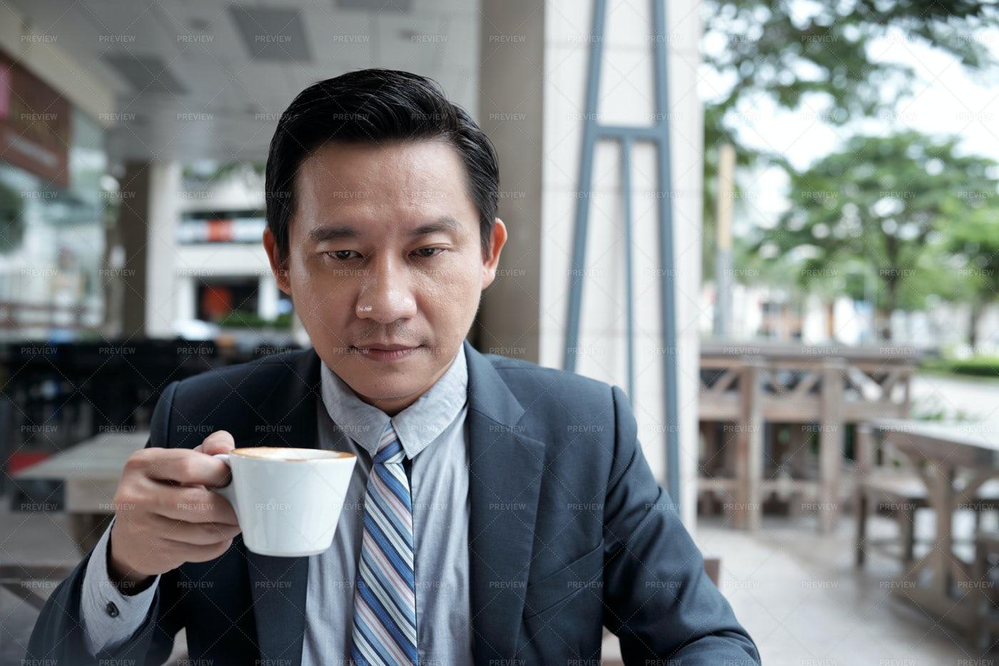 Serious Businessman In Cafe: Stock Photos