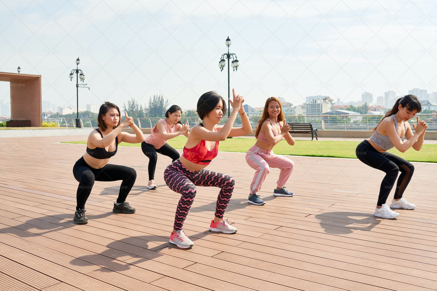 Contemporary Athletic Women Doing Yoga: Stock Photos