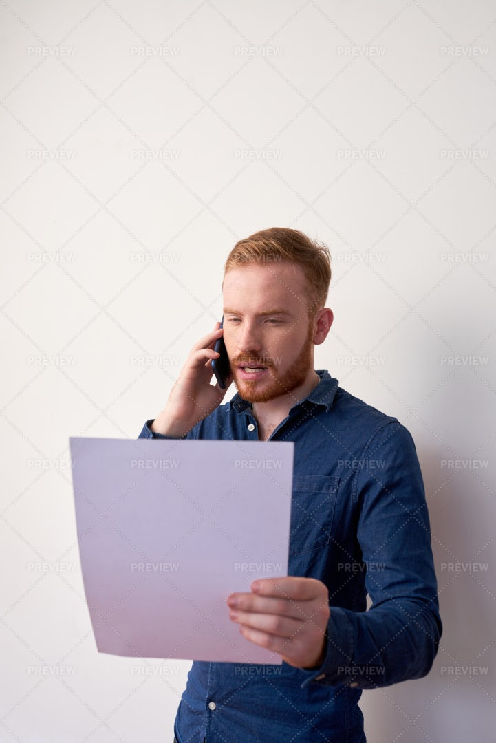 Entrepreneur Reading Important Document: Stock Photos